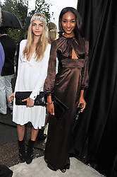 Left to right, CARA DELEVINGNE and JOURDAN DUNN at the annual Serpentine Gallery Summer Party sponsored by Burberry held at the Serpentine Gallery, Kensington Gardens, London on 28th June 2011.