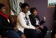 Teresita Torrence, right, speaks during their book club meeting in Sun Prairie, Wisconsin, Friday, Oct. 26, 2018.