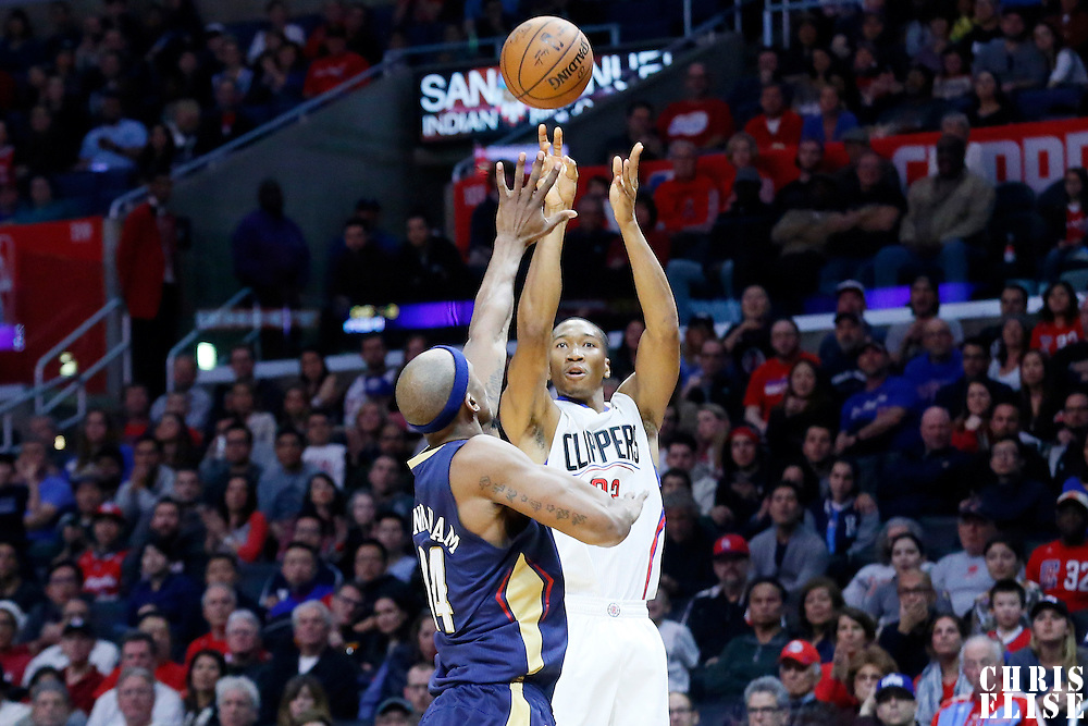 10 January 2016: Los Angeles Clippers forward Wesley Johnson (33) takes a jump shot over New Orleans Pelicans forward Dante Cunningham (44) during the Los Angeles Clippers 114-111 overtime victory over the New Orleans Pelicans, at the Staples Center, Los Angeles, California, USA.