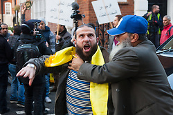 "Mayfair, London, November 28th 2014. A protest against Egypt's leader Al-Sisi descended into moinor scuffles as right wing ""patriots"" from anti-Islamic group Britain First arrived to protest against the presence of Islamist preacher Anjem Choudary, who was recently arrestred as part of an ant-terror operation. Playing patriotic British Music, Britain First accused Muslims of worshiping a ""devil"" and a ""paedophile prophet"". Police had to intervene before hotheads on both sides became violent. PICTURED: A protest organiser, right, tries to prevent one of his comrades from approaching the embassy and risking arrest."