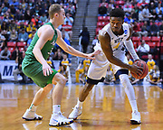 SAN DIEGO, CA - MARCH 18:  West Virginia Mountaineers guard Daxter Miles Jr. (4) looks to drive against Marshall Thundering Herd guard Jon Elmore (33) during a second round game of the Men's NCAA Basketball Tournament at Viejas Arena in San Diego, California.  (Photo by Sam Wasson)