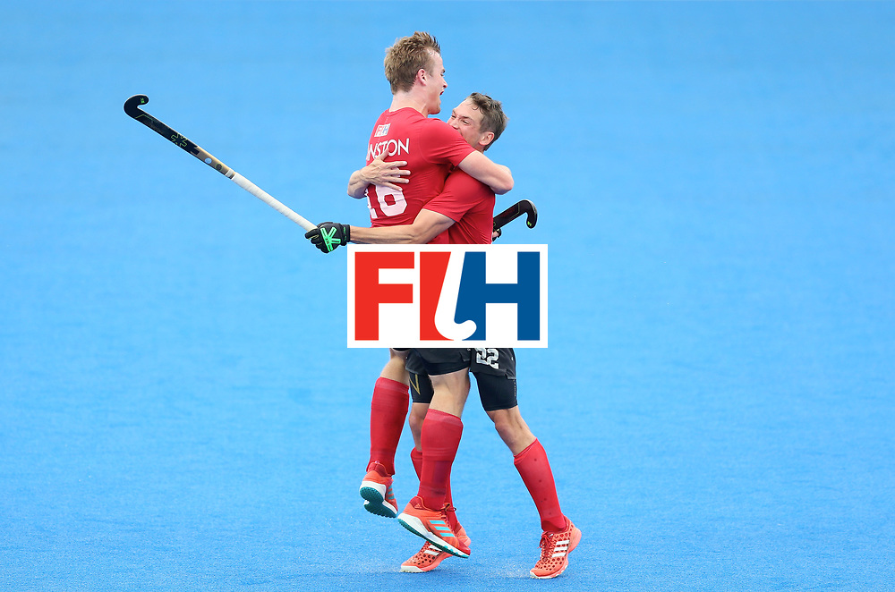 LONDON, ENGLAND - JUNE 25: Gordan Johnston of Canada celebrates scoring their teams third goal wiht teammate John Smythe of Canada during the 5th/6th place match between India and Canada on day nine of the Hero Hockey World League Semi-Final at Lee Valley Hockey and Tennis Centre on June 25, 2017 in London, England. (Photo by Steve Bardens/Getty Images)
