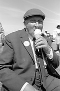 Retired Thurcroft member William Boot enjoys an ice-cream at the 99th Yorkshire Miners Gala. 1986 Doncaster.