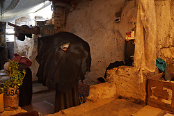 Preparing to leave for school, 13-year-old Alhanouf al Tamani peeks out from her niqab in Saada, Yemen, March 28, 2012. For the past three years, she has lived with her parents and six siblings in a single room - all that was left of the family home after fighting between government forces and insurgents virtually destroyed it. They're the lucky ones. Others, displaced by violence, make do in tents.
