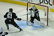May 26, 2013; San Jose, CA, USA; San Jose Sharks goalie Antti Niemi (31, right) makes a save in front of defenseman Justin Braun (61) against the Los Angeles Kings during the first period in game six of the second round of the 2013 Stanley Cup Playoffs at HP Pavilion.