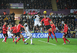Swansea City's Wilfried Bony scores with a header. - Photo mandatory by-line: Alex James/JMP - Tel: Mobile: 07966 386802 08/02/2014 - SPORT - FOOTBALL - Swansea - Liberty Stadium - Swansea City v Cardiff City - Barclays Premier League
