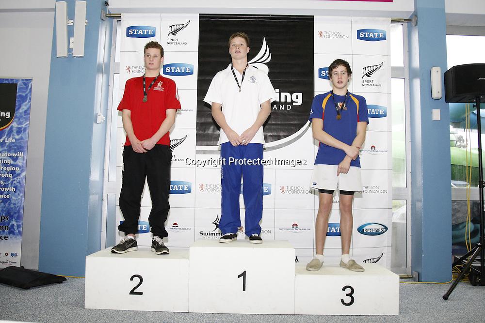 Medal presentation.  State Secondary Schools Swimming Champs.  Day 1, 7 September 2012.  Te Rapa, Hamilton.  Photo:  Bruce Lim / photosport.co.nz