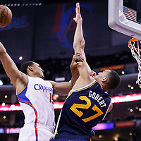 23 October 2013: Los Angeles Clippers center Ryan Hollins (15) goes for the dunk over Utah Jazz center Rudy Gobert (27) during the Los Angeles Clippers 103-99 victory over the Utah Jazz at the Staples Center, Los Angeles, California, USA.