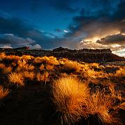 The sun rises over the desert southwest during a brief rainstorm in Utah.