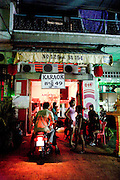 Karaoke bar in Phnom Penh. Karraoke bars, most times serve as a front for brothels often with underaged prostitutes.