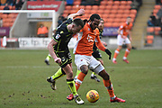 Blackpool Forward, Nathan Delfouneso (30) and Bristol Rovers Midfielder, Ollie Clarke (8) during the EFL Sky Bet League 1 match between Blackpool and Bristol Rovers at Bloomfield Road, Blackpool, England on 13 January 2018. Photo by Mark Pollitt.