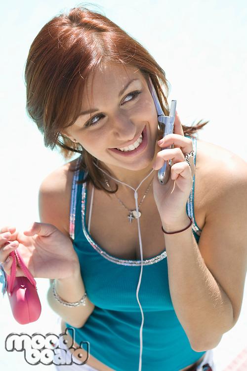 Teenage Girl (18-19) Talking on Mobile, Smiling
