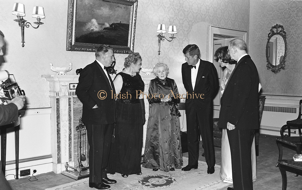 c333 5175<br /> <br /> 28.6.63<br /> President Kennedy entertained by President de Valera<br /> <br /> President Kennedy was to-night entertained at a dinner party given by the President of Ireland <br /> Mr. Eamon de Valera at Aras an Uachearain, (the home of the Predsident) Phoenix Park, Dublin. Included in the group are (l-r) An Taoiseach (Premier) <br /> Sean Lemass and Mrs. Lemass, Mrs. de Valera wife of the President , President Kennedy,<br /> Mrs. Eunice Shriver and President de Valera. *** Local Caption *** It is important to note that under the COPYRIGHT AND RELATED RIGHTS ACT 2000 the copyright of these photographs are the property of Lensmen & Associates and they cannot be copied, scanned, reproduced or electronically stored in any form whatsoever without the written permission of Lensmen & Associates.