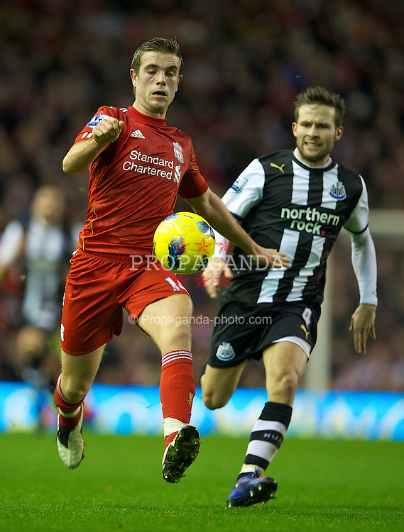 LIVERPOOL, ENGLAND - Friday, December 30, 2011: Liverpool's Jordan Henderson in action against Newcastle United's Yohan Cabaye during the Premiership match at Anfield. (Pic by David Rawcliffe/Propaganda)