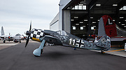 Focke Wulf FW190 replica being pushed out of hangar.