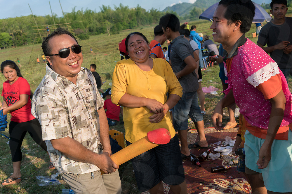 May 10, 2017 - Muang Nan (Laos). A drunk man jokes with a wood penis. The festival is also linked to fertility and farmers pray to gods to ensure a successful crop for the next season. © Thomas Cristofoletti / Ruom