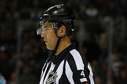 Dec 8, 2011; San Jose, CA, USA; NHL referee Wes McCauley (4) before a face off between the San Jose Sharks and the Dallas Stars during the first period at HP Pavilion.  San Jose defeated Dallas 5-2. Mandatory Credit: Jason O. Watson-US PRESSWIRE