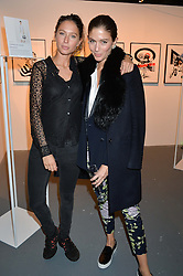 Left to right, sisters JEMIMA JONES and QUENTIN JONES at the Women for Women International Catwalk Show & Auction in partnership with Brown's and sponsored by Swarovski held at The Vinyl Factory, Brewer Street Space, Brewer Street, London on 20th November 2014.