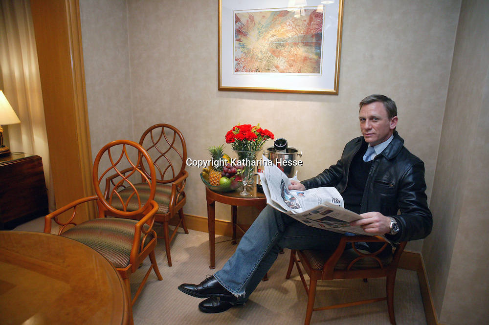 BEIJING, JANUARY-29: Daniel Craig reads a paper in a hotel before  the premiere of Casino Royale in Beijing.