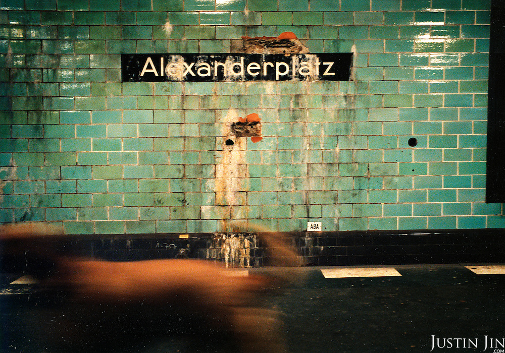 A dog walks on the platform of Berlin's Alexanderplatz metro station..Picture taken 2005 by Justin Jin
