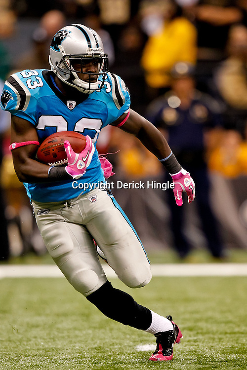 October 3, 2010; New Orleans, LA, USA; Carolina Panthers running back Mike Goodson (33) returns a kickoff against the New Orleans Saints during a game at the Louisiana Superdome. The Saints defeated the Panthers 16-14. Mandatory Credit: Derick E. Hingle