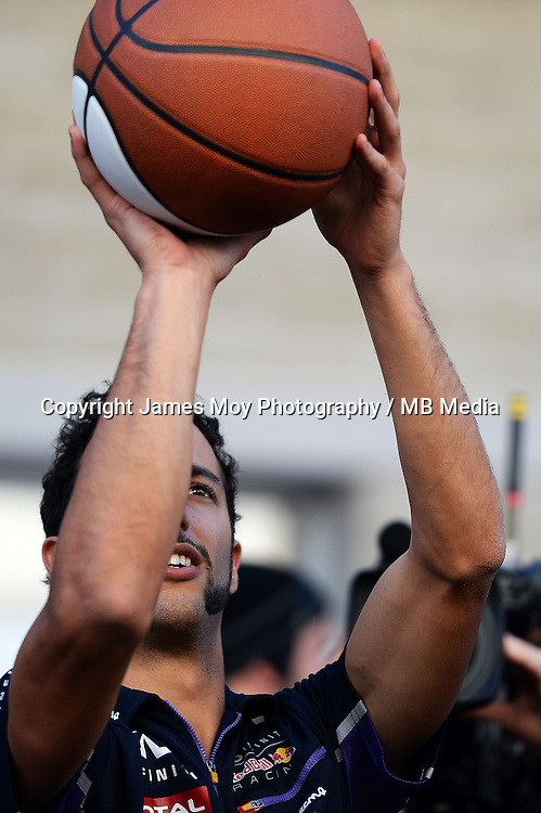Daniel Ricciardo (AUS) Red Bull Racing practices his basketball skills.<br /> United States Grand Prix, Saturday 1st November 2014. Circuit of the Americas, Austin, Texas, USA.