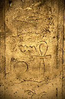 Frieze on the wall of a chamber in the Persian Shaft in Sakkara, Egypt showing symbols and hieroglyphics.