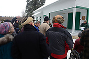 The remote community of Yaak Montana listens to a talk by Kootenai Natioanal Forest supervisor Chris Savage during a ceremony for the cutting of the 2017 Capitol Christmas tree at the Historic Upper Ford Ranger Station in the upper Yaak Valley. Purcell Mountains, northwest Montana.