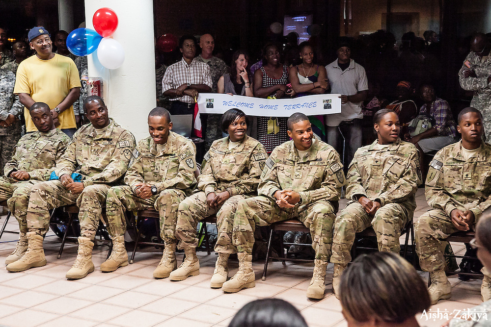 (L-R) SSG Ephraim Sydney, SSG Rae Rouse, SGT Okil Freeman, SGT Domice Benjamin, SPC Janeel Gumbs, SPC Donna Bellot, SPC Terrance Bartley.  Welcome home ceremony for the St. Thomas based soldiers of the 104th Troop.Command Rapid Aerostat Initial Deployment (RAID) Teamat the Cyril E. King.Airport.  VING's 104th RAID unit deployed to Afghanistan in support of Operation New Dawn. 2 September 2012.  © Aisha-Zakiya Boyd