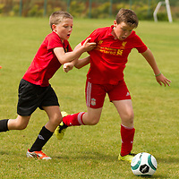 Callum Dobbin pulls back Joseph Flanagan before he shoots for goal at the FAI Eflow Summer Soccer School in Lisdoonvarna