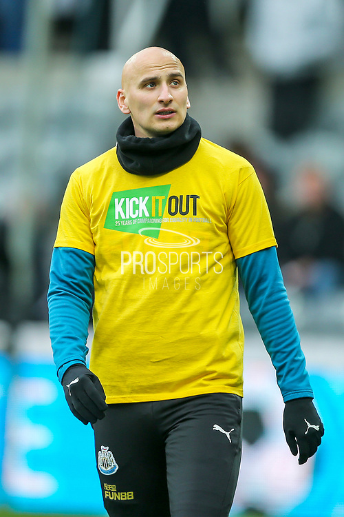 Jonjo Shelvey (#8) of Newcastle United wearing a 'Kick It Out' campaign t-shirt during the warm-up ahead of the Premier League match between Newcastle United and Crystal Palace at St. James's Park, Newcastle, England on 6 April 2019.