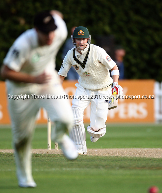 Australia's Michael Clarke drives the ball past Daniel Vettori.<br /> 1st cricket test match - New Zealand Black Caps v Australia, day one at the Basin Reserve, Wellington.Friday, 19 March 2010. Photo: Dave Lintott/PHOTOSPORT