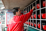 ANAHEIM, CA - JUNE 03:  Assistant Equipment Manager Shane Demmitt of the Los Angeles Angels of Anaheim does some work in the Angels dugout before the game against the Texas Rangers on Sunday, June 3, 2012 at Angel Stadium in Anaheim, California. The Rangers won the game 7-3. (Photo by Paul Spinelli/MLB Photos via Getty Images) *** Local Caption *** Shane Demmitt