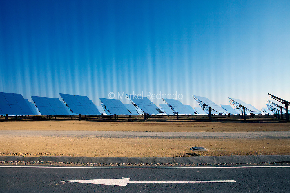 PS10 solar power tower is a 11 MW plant produces electricity with 624 large heliostats. Each of these mirrors has a surface measuring 120 square meters (1,290 square feet) that concentrates the Sun's rays to the top of a 115 meter (377 feet) high tower where a solar receiver and a steam turbine are located. The turbine drives a generator, producing electricity. It is located in Sanlucar la Mayor, near Seville, and it is owned by Abengoa Solar.