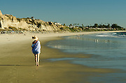 Woman Walking Along the Beach in Orange County
