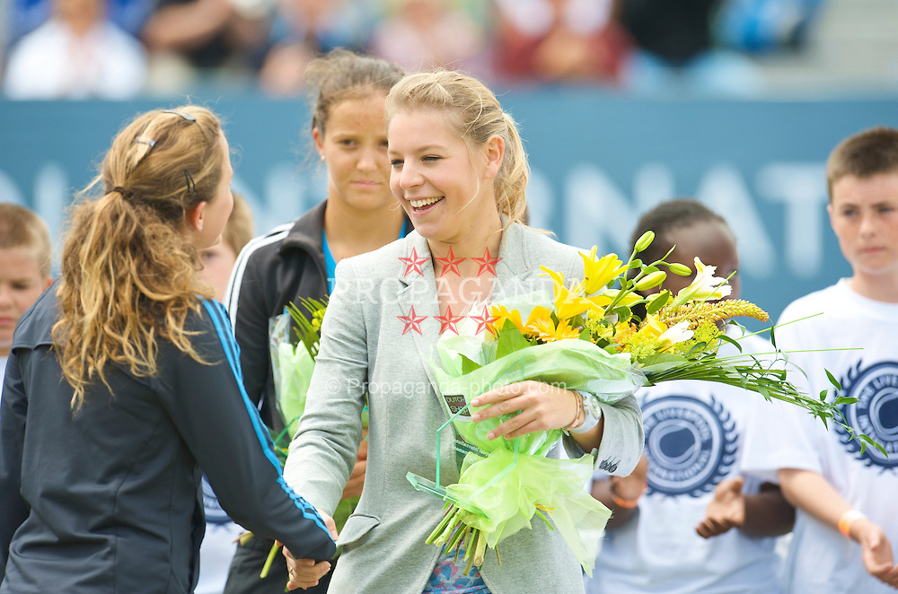 LIVERPOOL, ENGLAND - Saturday, June 20, 2009: Tournament organiser Eliza Holyman presents winner Michelle Larcher De Brito (POR) with flowers during Day Four of the Tradition ICAP Liverpool International Tennis Tournament 2009 at Calderstones Park. (Pic by David Rawcliffe/Propaganda)