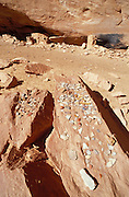 Pottery sherds and granaries at Turkey Pen Ruin, Grand Gulch Primitive Area, Utah USA