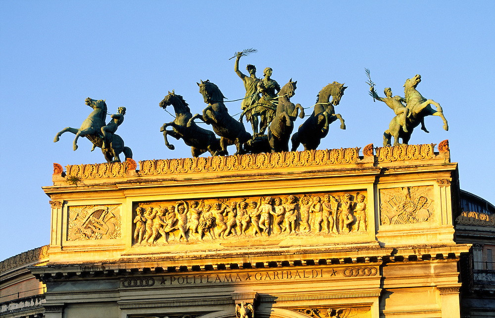 Palermo. Bronze statues by Rutelli on top of the Politeama Garibaldi theatre, Palermo, Sicily, Italy