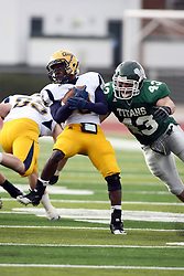 12 November 2011:  Antonio Owens makes the catch as Ryan Penders catches him during an NCAA division 3 football game between the Augustana Vikings and the Illinois Wesleyan Titans in Tucci Stadium on Wilder Field, Bloomington IL