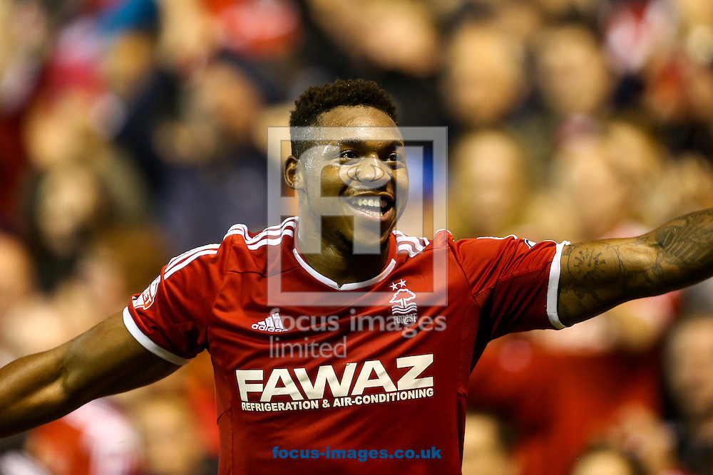 Britt Assombalonga of Nottingham Forest celebrates after scoring the fourth goal for Forest during the Sky Bet Championship match at the City Ground, Nottingham<br /> Picture by Andy Kearns/Focus Images Ltd 0781 864 4264<br /> 17/09/2014