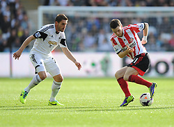 Sunderland's Adam Johnson turns away from Swansea City's Angel Rangel - Photo mandatory by-line: Alex James/JMP - Tel: Mobile: 07966 386802 19/10/2013 - SPORT - FOOTBALL - Liberty Stadium - Swansea - Swansea City v Sunderland - Barclays Premier League