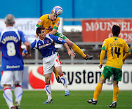 Carlisle - Saturday October 10th, 2009: Scott Dobie of Carlisle United is beaten in the air by Gary Doherty of Norwich City during the Coca Cola League One match at Brunton Park, Carlisle. (Pic by Jed Wee/Focus Images)..