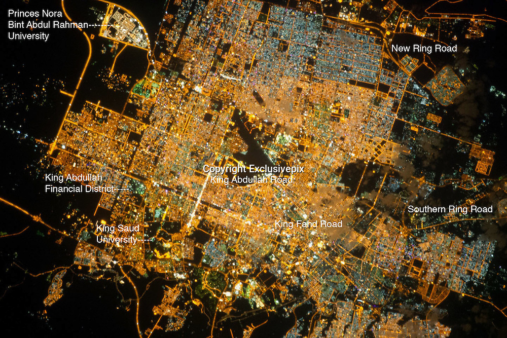 City's By Night<br /> <br /> Riyadh at Night<br /> <br /> The population of Riyadh, the capital city of Saudi Arabia, has risen dramatically in the last half century'from 150,000 in 1960 to 5.4 million in 2012. The city appears as a brightly colored patchwork in this nighttime astronaut photograph. The brightest lights, apart from those on the old Riyadh Airbase, follow the commercial districts along King Abdullah Road and King Fahd Branch Road. Many of the darker patches within the built area are city parks.<br /> University sectors stand out with different street and light patterns, including the King Saud University campus'which houses the Arabic Language Institute'and the Princess Nora Bint Abdul Rahman University'which is the largest all-female university in the world. Highways and various ring roads also stand out due to bright, regular lighting. Lighted developments beyond the ring roads mark the growth of the city (image lower left and lower right). Newer neighborhoods, set further from the city center, are recognizable by blue-gray lightning.<br /> ©Earth Observatory/Exclusivepix