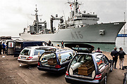 "05 November 2017, Salerno Italy - The arrival of Spanish military ship ""Cantabria"" in the harbour of Salerno. On board 375 migrants and 26 dead bodies of girls. Migrants were rescued on 03 November near the Libyan coast. On the pier to wait the migrants, over the autorities, 26 hearses."