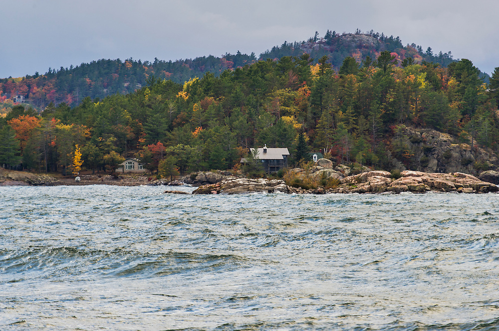 Fall storms roll across a wave swept Lake Superior along Highway M-28 near Marquette, Michigan in autumn on Michigan's Upper Peninsula.