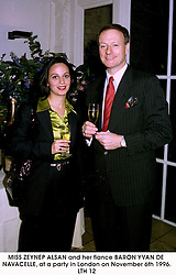 MISS ZEYNEP ALSAN and her fiance BARON YVAN DE NAVACELLE, at a party in London on November 6th 1996.LTH 12