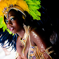 London, UK - 27 August 2012: a reveller in a costume takes shelter from the rain during the annual Notting Hill Carnival.