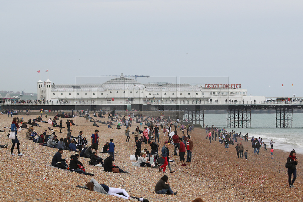 © Licensed to London News Pictures. 04/05/2015. Brighton, UK. Hundreds of people come out to the beach during the May Bank Holiday weekend, Today Monday May 4th 2015 Photo credit : Hugo Michiels/LNP