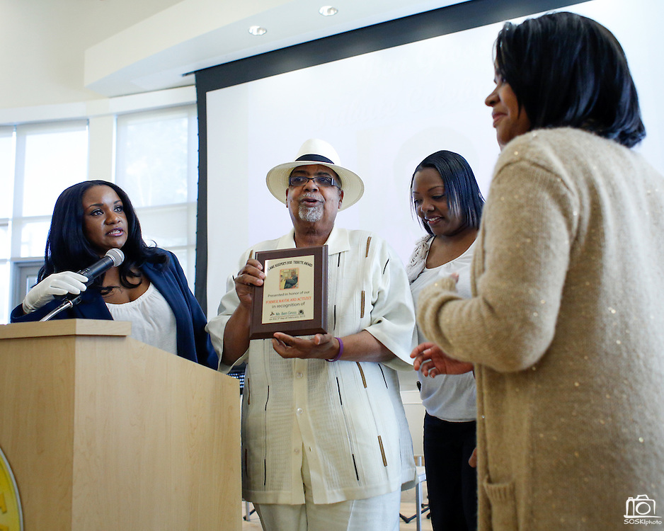 Demetress Morris of NAACP and Black Caucus of Milpitas presents a plaque honoring former Mayor Ben Gross to Ben Gross Jr. (son), Malika Patterson (granddaughter), and Lynn Gross (wife), from left to right, during the Tribute Celebration for former Mayor Ben Gross at the Sandra Lee Senior Center in Milpitas, California, on February 23, 2013. (Stan Olszewski/SOSKIphoto)