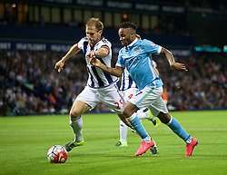 WEST BROMWICH, ENGLAND - Monday, August 10, 2015: Manchester City's Raheem Sterling in action against West Bromwich Albion's Craig Dawson during the Premier League match at the Hawthorns. (Pic by David Rawcliffe/Propaganda)